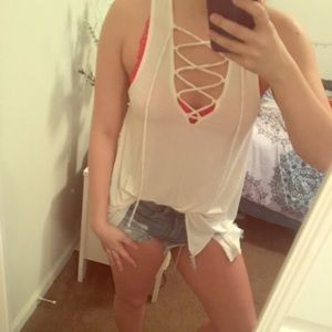 A lace up cream tank top